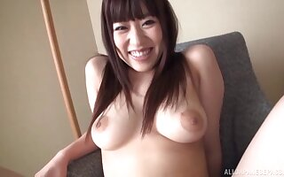 Handsome solo Japanese babe plays with the brush natural tits and pussy