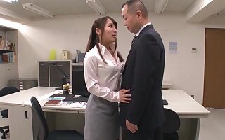 Kinky secretary from Japan drops primarily the brush knees to take a blowjob