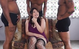 Japanese model Saegusa Chitose pleasures entirety of big black cocks