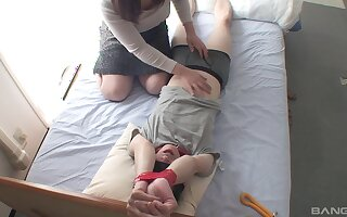 Hidden cam records horny Japanese girl pleasuring a tied up guy