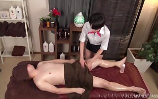 Lucky guy gets a massage and his dick pleasured by a Japanese chick