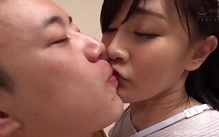 Japanese hottie pleasures her man with a handjob in the kitchen