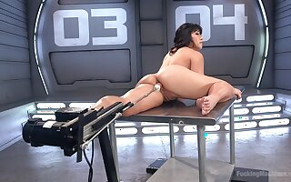 Busty Asian babe Mia Little gets double penetrated  by two fuck machines
