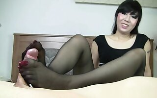 Foxy Asian mistress Sweet Coco gives a great BJ and wanks a dick with her long toe nails