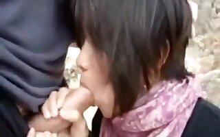 Short haired oriental wife sucks jock