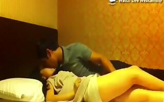 Nerdy asian guy makes a sextape with his hot asian gf