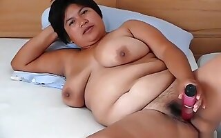 She plays with her pussy.